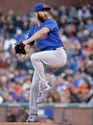 Chicago Cubs starting pitcher Jake Arrieta throws against the San Francisco Giants in the first inning of their baseball game Friday, May 20, 2016, in San Francisco.