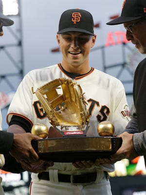 San Francisco Giants second baseman Joe Panik is presented a Gold Glove award during a ceremony Wednesday's game in San Francisco.