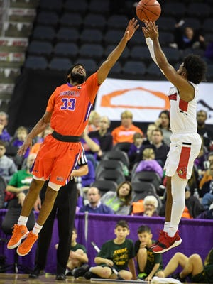 Illinois State's Keyshawn Evans (3) shoots over University of Evansville's K.J. Riley (33) as the University of Evansville plays Illinois State on West Side Day at the Evansville Ford Center Saturday, December 23, 2017.