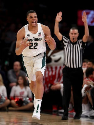 Miles Bridges #22 of the Michigan State Spartans celebrates his three point shot in the first half against the Wisconsin Badgers during quarterfinals of the Big Ten Basketball Tournament at Madison Square Garden on March 2, 2018 in New York City.