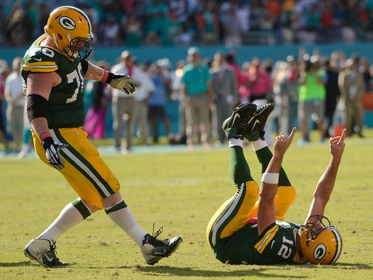 Packers quarterback Aaron Rodgers celebrates after throwing the game winning-touchdown in the closing seconds against the Dolphins.