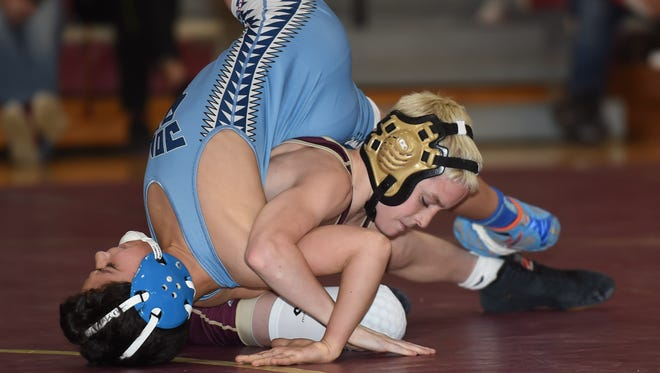 Arlington's Dennis Robin wrestles against John Jay's Marcello Bernasconi in the 99-lb. weight class last year. Robin is among the top returning area wrestlers this year.