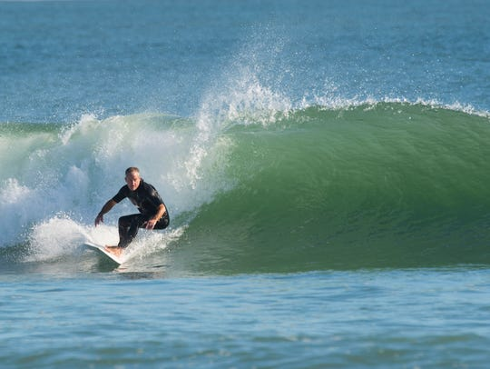 """""""This is almost like a surfer's church,"""" said Charles Williams, maker of Impact surfboards, after a Sunday morning surf Nov. 19, 2017, at Fort Pierce Inlet State Park on North Hutchinson Island. Williams started surfing at the age of 14 and since then has prioritized time in the water. """"My dad used to say 'Every time opportunity comes knocking at your door, you're at the beach.'"""" Williams now produces 300 to 500 Impact surfboards per year, his flexible schedule allowing him to surf """"when the tides are right."""""""