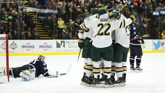 The Catamounts celebrate a goal during the men's hockey game between the UConn Huskies and the Vermont Catamounts at Gutterson Field House on Friday night November 13, 2015 in Burlington.