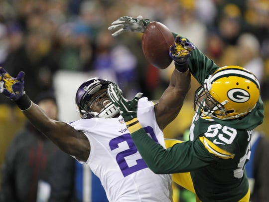 The Minnesota Vikings' Xavier Rhodes breaks up a pass intended for the Green Bay Packers' James Jones during the first half Jan. 3 in Green Bay, Wis.