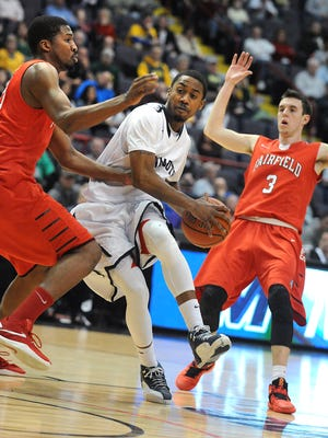 Monmouth's Je'lon Hornbeak is guarded by Fairfield's Coleman Johnson, left, and Tyler Nelson, right, during the MAAC semifinals at the Times Union Center on Sunday, March 6, 2016 in Albany, N.Y. (Lori Van Buren)