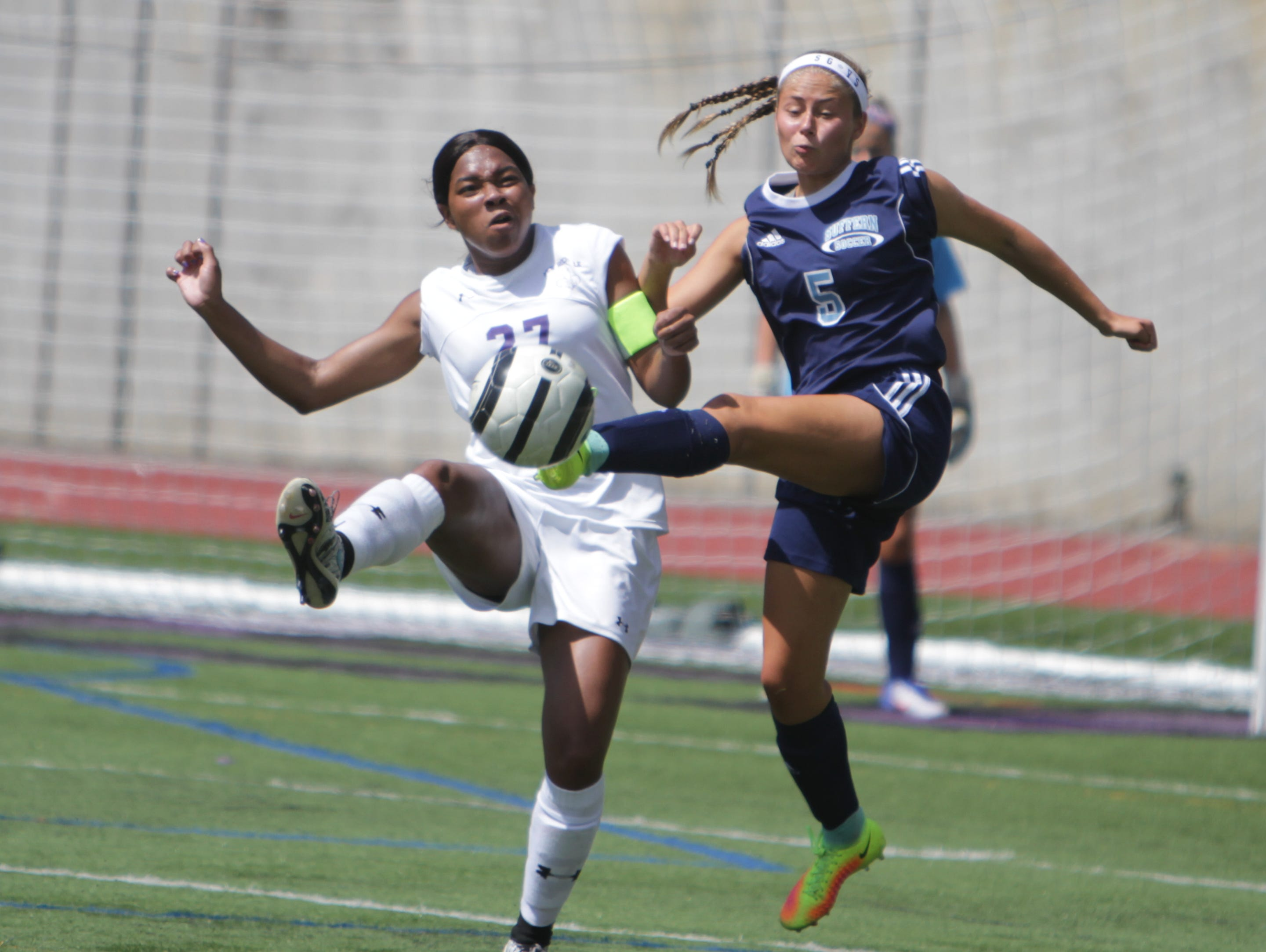 New Rochelle's Sydney Jasper (27) and Suffern's Abby Bosco (5) battle for possession of the ball during a Section 1 girls soccer game between New Rochelle and Suffern at New Rochelle High School Friday, Sept. 2. Suffern won 4-1.