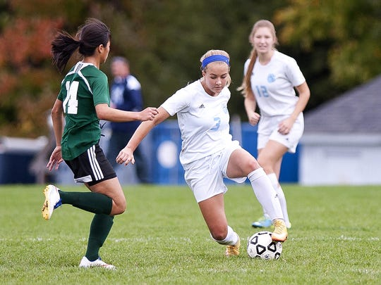 Mount Mansfield midfielder Allie Charland (3) controls the ball before dribbling past a St. Johnsbury player during the second half of Saturday's girls soccer game in Jericho.