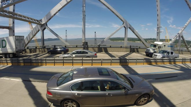 Traffic moves on the Tappan Zee Bridge as construction continues for the new bridge which will replace it June 24, 2015.