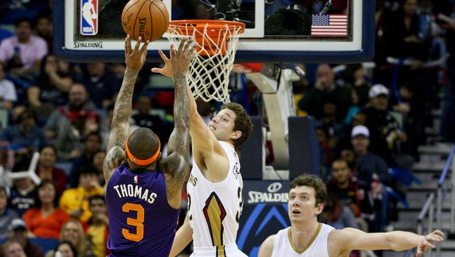 Phoenix Suns guard Isaiah Thomas (3) shoots over New Orleans Pelicans guard Jimmer Fredette (32) during the second quarter of a game at Smoothie King Center in New Orleans on Dec. 30.