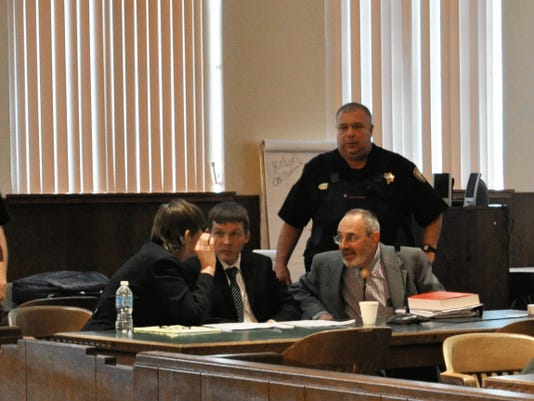 JESSICA ONSUREZ CURRENT-ARGUS   Robert Earley (center), 33, consults with his defense lawyers at the Eddy County Courthouse. Earley was convicted by a jury of first degree murcder and sentenced to life in prison wihtoutthe possibiity of parole.
