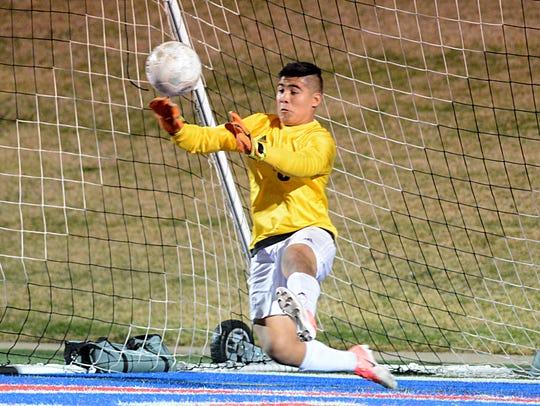 Abilene High goalkeeper Bryan Bocanegra makes a save