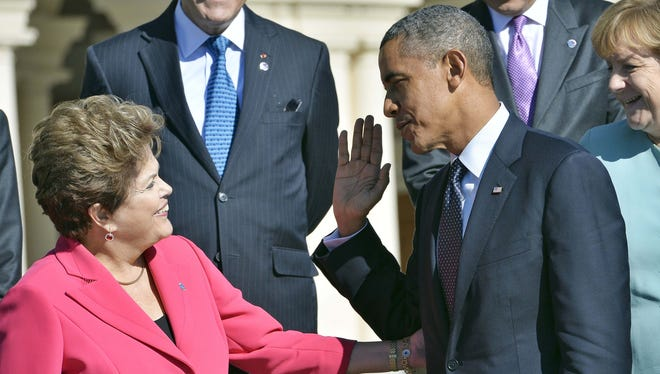 President Obama and Brazil President Dilma Rousseff attend the recent G-20 summit.
