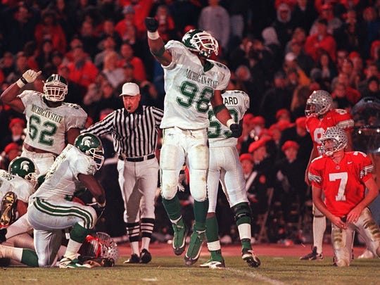 MSU's Julian Peterson, center, celebrates his sack of Ohio State quarterback Joe Germaine, right, and the forced fumble the  recovered by the Spartans. MSU's 28-24 win in 1998 in Columbus can be a blueprint of sorts for this week.