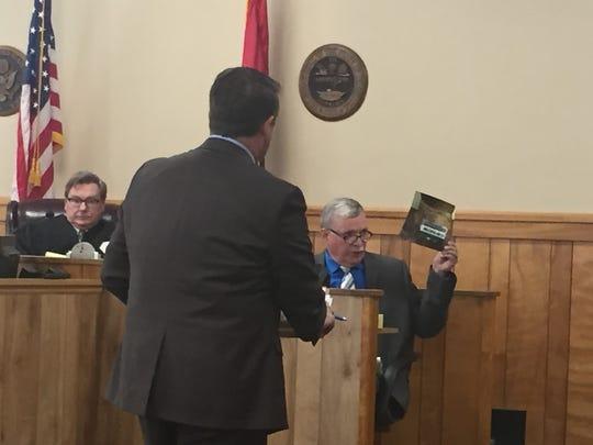 Medical Examiner Dr. Thomas Deering shows the jury