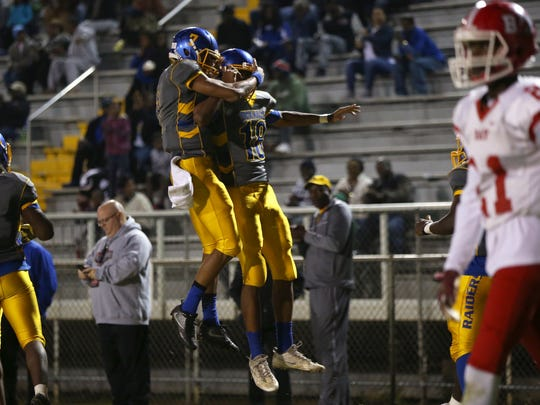Rickards' quarterback D.J. Phillips, left, celebrates with Simon Phillips after they connected on a two-point conversion during their FHSAA playoff game against Panama City's Bay High School at Cox Stadium on Thursday, Nov. 10, 2016.