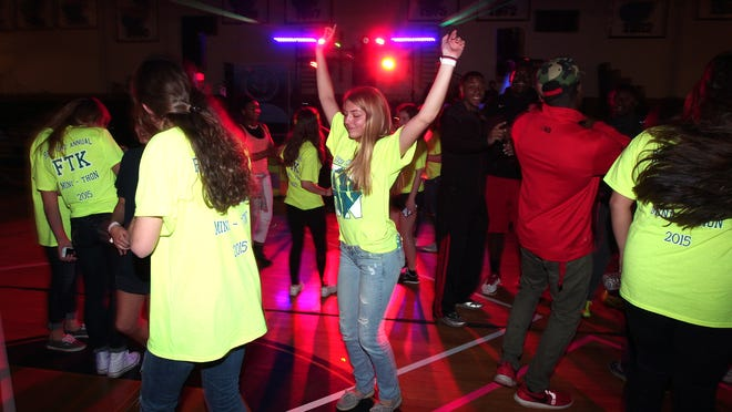 Roxbury High School student Hannah Bhend dances with classmates at the start of the schools second annual nine hour mini-THON, a dance/celebration to raise money for families facing pediatric cancer.