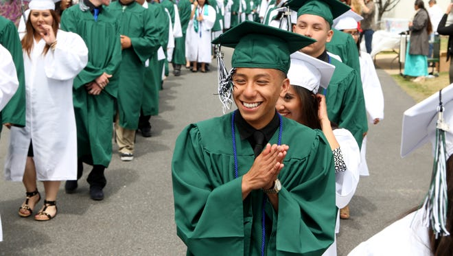 A graduate from Alisal High School's 50th graduating class gets pumped before the commencement ceremony began on Thursday.