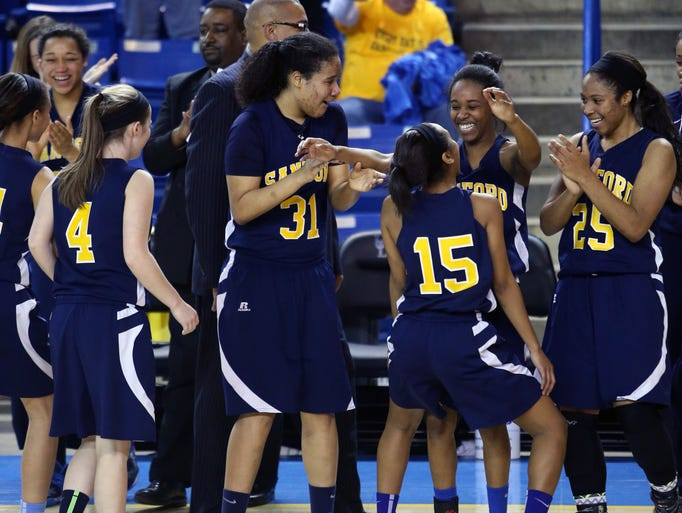 Sanford begins celebrating as time runs out in the Warriors' 58-37 win against St. Elizabeth in the DIAA state high school championship Friday, March 7, 2014 at the Bob Carpenter Center.