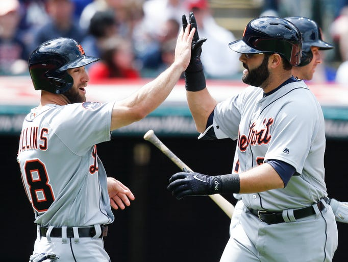 The Tigers' Alex Avila, left, gets congratulations