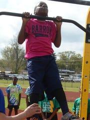 J.I. Barron Elementary School student Ashton Mollette completes eight pull-ups at the Rapides Parish Fitness Meet held Wednesday at Alexandria Senior High School.