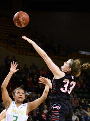 Colorado City's Conley Niblett shoots over Idalou's