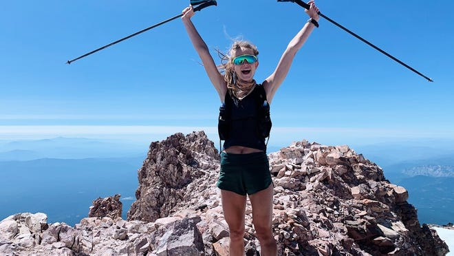 Mill Valley's Sarah Burke celebrates after seting the record for the fastest ascent by a female of Mt. Shasta, from Horse Camp to the summit on July 18, 2020, completing the feat in two hours, 55 minutes.