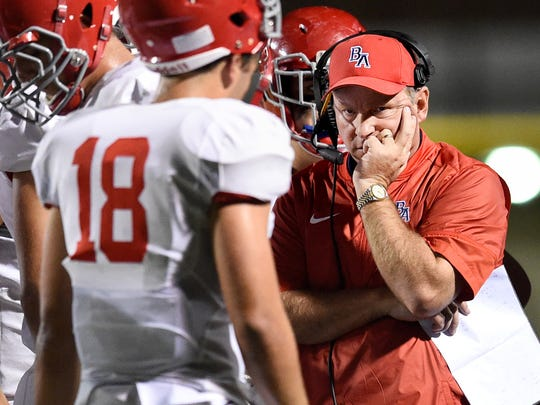 Brentwood Academy's head coach Cody White speaks to his team during the first half of  against Montgomery Bell Academy on Friday, Oct. 7, 2016, in Nashville, Tenn.