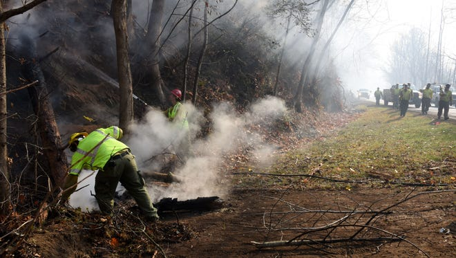 A forestry crew from South Dakota was cleaning up along the spur after wild fires burned multiple business and homes in Gatlinburg causing a mandatory evacuation Tuesday, Nov. 29, 2016.