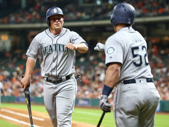 Seattle Mariners third baseman Kyle Seager (left) is congratulated by catcher Carlos Ruiz after scoring a run during the fifth inning against the Houston Astros at Minute Maid Park.