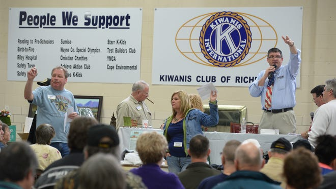 An item is sold during the 51st Annual Kiwanis Auction on March 22, 2014, at the National Guard Armory in Richmond.