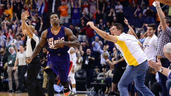 Phoenix Suns guard Eric Bledsoe (2) celebrates after making the game winning three point basket against the Portland Trail Blazers during overtime at Talking Stick Resort Arena. The Suns defeated the Trail Blazers 118-115.