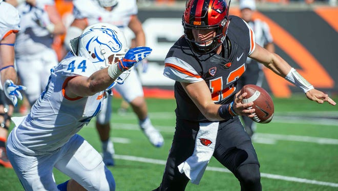 Sep 24, 2016; Corvallis, OR, USA; /Oregon State Beavers quarterback Conor Blount (12) dodges Boise State Broncos linebacker Darren Lee (44) during the fourth quarter at Reser Stadium. Mandatory Credit: Cole Elsasser-USA TODAY Sports