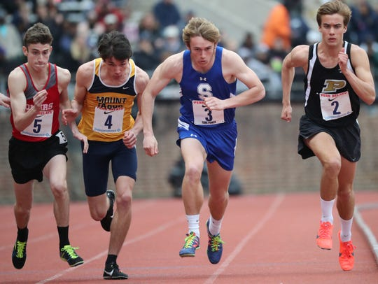 Drew Maher (3), of Shore Regional, starts the mile