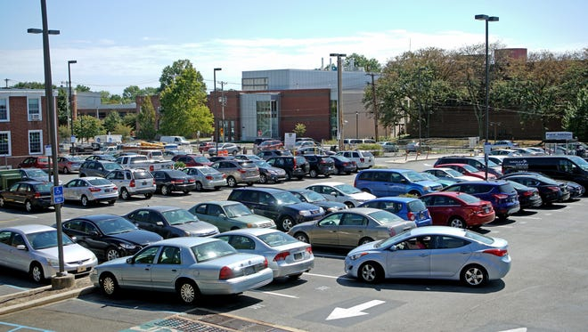Motorists navigate a parking lot between Main Street and East Delaware Avenue in Newark on Thursday. The city in 2014 hired a consultant to evaluate downtown's parking capacity.