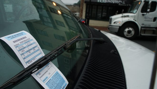 A vehicle along Market Street in Wilmington is ticketed.