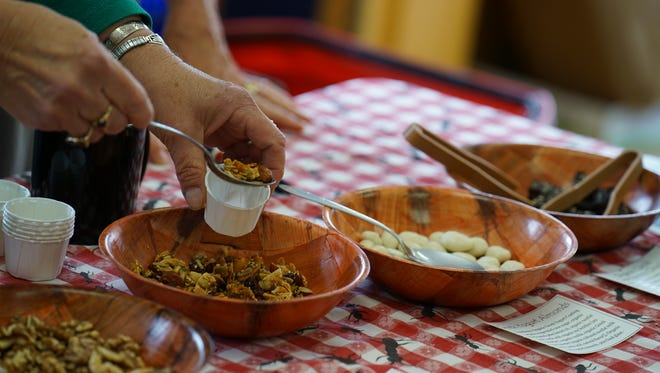 Tasty dishes are served at the Silver City Food Co-op last year during the Taste of Downtown.