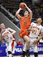 Marlboro High School's John Perugino takes a jump shot between Olean's Derek Schmidt and Elijah Ramadhan during the state Class B championship in Glens Falls on Saturday.