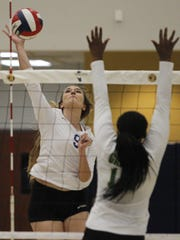 Exeter's Olivia Harden looks to spike one against Garces