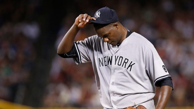 New York Yankees' Michael Pineda pauses on the mound after giving up a run against the Arizona Diamondbacks during the second inning of a baseball game Tuesday, May 17, 2016, in Phoenix.