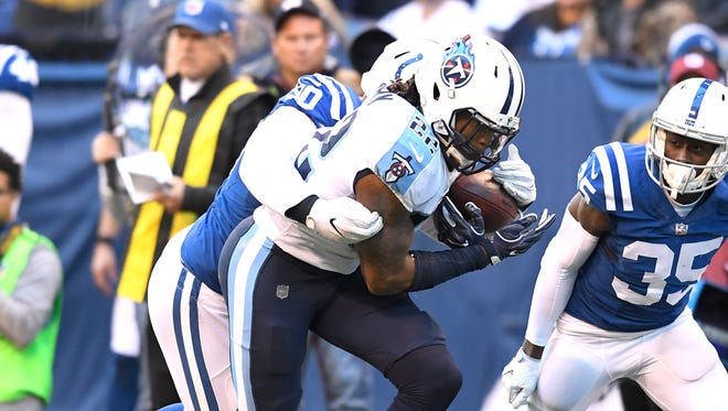 Titans running back Derrick Henry (22) races up the field for a first down in the fourth quarter at Lucas Oil Stadium Sunday, Nov. 26, 2017 in Indianapolis, Ind.