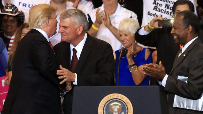 President Trump hugs Christian evangelist Franklin Graham at a campaign rally at the Phoenix Convention Center in Phoenix last August.