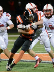 Making a stop on Northville's Terrell Cunningham during