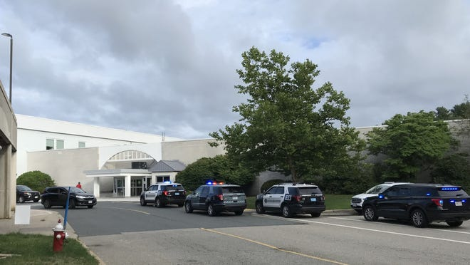 Police vehicles parked outside the Auburn Mall on Southbridge Street early Friday evening.