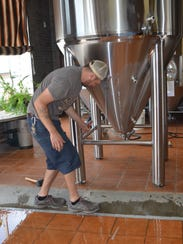 Stacey Uchtman, head brewer, adjusts the new 20 barrel