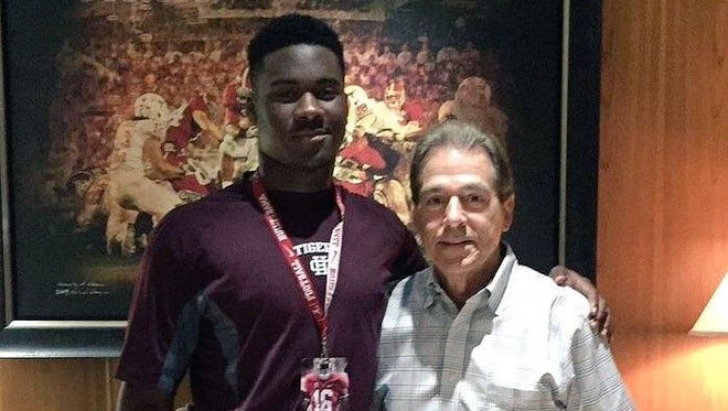 Hardin County's LaTrell Bumphus got his picture taken with Alabama head coach Nick Saban while on a recruiting trip to Tuscaloosa this weekend.