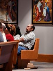 A parishioner in the Sagrado Corazon congregation leaves