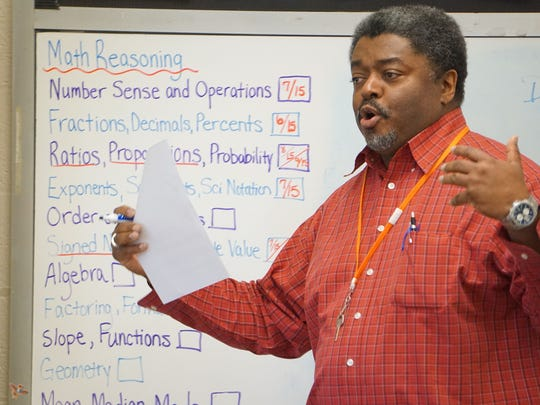 Cliff Chandler teaches math Thursday afternoon at the