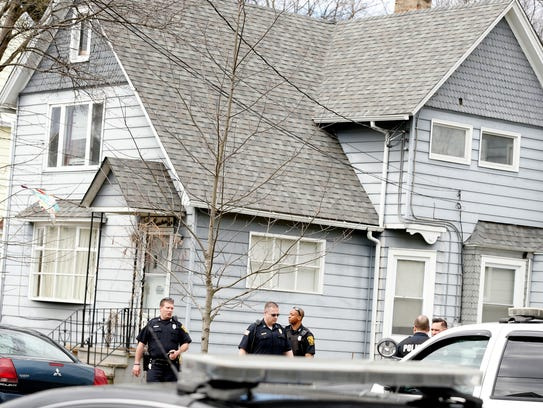 Elmira police exit an apartment on the 500 block of
