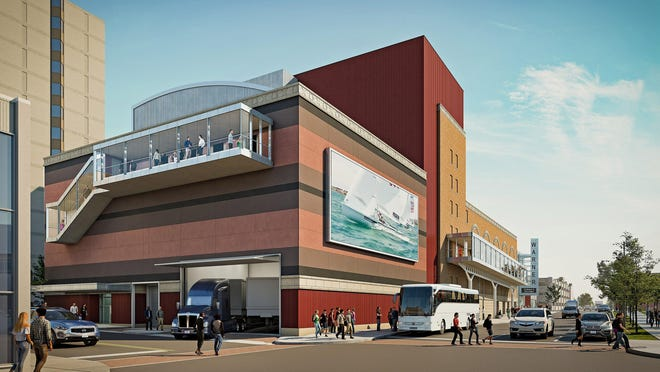 This is an architect's rendering of the expanded Warner Theatre in Erie, including a large outdoor video screen, center, that will be part of the theater's addition, and enclosed walkways. This view looks northwest from the intersection of East Ninth and French streets. The renovation project is expected to wrap up in September of 2021.